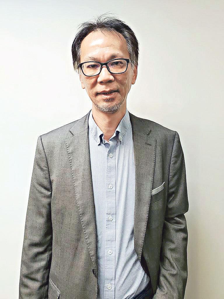 恒富移民控股有限公 司項目總監李永健(Simon)